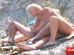 public mature blow job at a beach